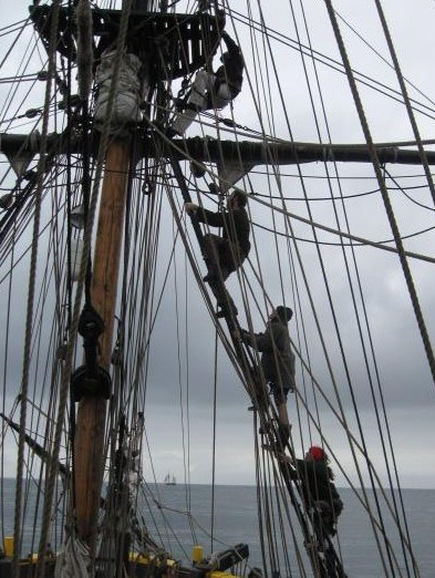 Crew going up to set the sails to come down!