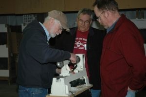 Scott Morrison showing Jim Smith and Don Nissen the finer points of horn making.